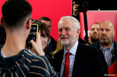 Britain's opposition Labour Party leader Jeremy Corbyn poses for a photo after speaking at a campaign event in Lancaster, England, Nov. 15, 2019.