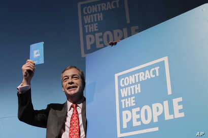 Nigel Farage, Leader of Britain's Brexit Party poses for photographers after speaking on stage at the launch of their policies…