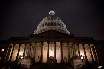 The Dome of the U.S. Capitol is visible in the early morning hours as counselors for the Judiciary and Intelligence Committees.