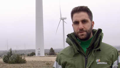 Iberdrola engineer Alonso Soberon says the sharp price drop for wind makes it competitive against fossil fuels, and one solution to fighting climate change. (Lisa Bryant/VOA)