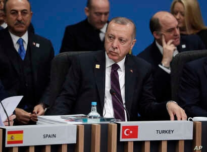 Turkish President Recep Tayyip Erdogan participates in a round table meeting during a NATO leaders meeting at The Grove hotel and resort in Watford, Hertfordshire, England, Dec. 4, 219.