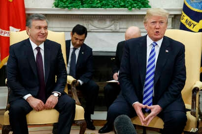 FILE - President Donald Trump (R) speaks during a meeting with Uzbek President Shavkat Mirziyoyev in the Oval Office of the White House, in Washington, May 16, 2018.