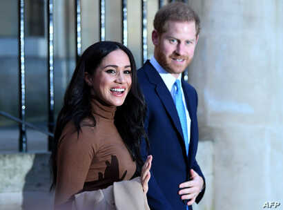 (FILES) In this file photo taken on January 07, 2020 Britain's Prince Harry, Duke of Sussex and Meghan, Duchess of Sussex react…