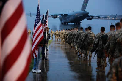 Paratroopers assigned to 1st Brigade Combat Team, 82nd Airborne Division prepare equipment and load aircraft bound for the U.S…