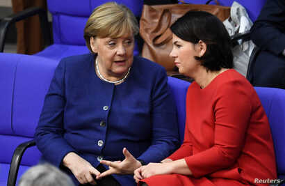 German Chancellor Angela Merkel talks to Leader of Germany's Green Party Annalena Baerbock during a plenum session on organ…