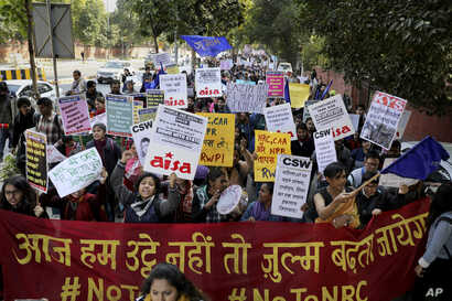 Indian students and activists participate in a protest rally against a new citizenship law, in New Delhi, Jan. 3, 2020.