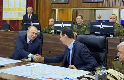 This image released by the Syrian Presidency shows Russian President Vladimir Putin, left, meeting with Syrian President Bashar Assad, center, in Damascus, Syria, Jan. 7, 2020.