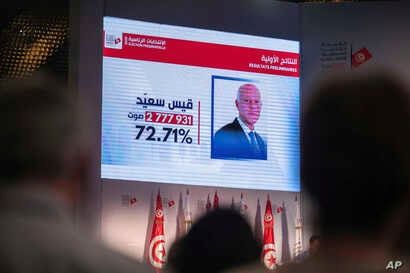 Journalists and observers attend as the Independent High Electoral Commission announces the results of the presidential election in Tunisia, Oct. 14, 2019.