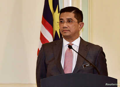 FILE - Malaysia's Minister of Economic Affairs Azmin Ali gives a news conference after a High-Speed Rail (HSR) signing ceremony at Putrajaya, Sept. 5, 2018.