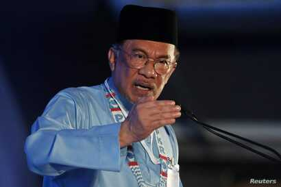 FILE - President of the People's Justice Party Anwar Ibrahim gives the keynote address during their general assembly in Melaka, Malaysia, Dec. 7, 2019.