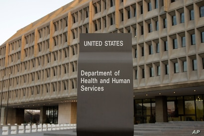 The Department of Health and Human Services building is seen in the evening in Washington