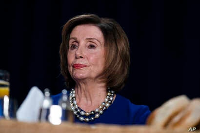 Speaker of the House Nancy Pelosi of Calif., listens as President Donald Trump speaks at the 68th annual National Prayer…