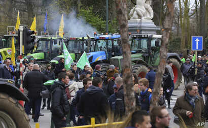 Farmers and tractors gather outside of an EU summit in Brussels, Thursday, Feb. 20, 2020. Baltic farmers on Thursday were…