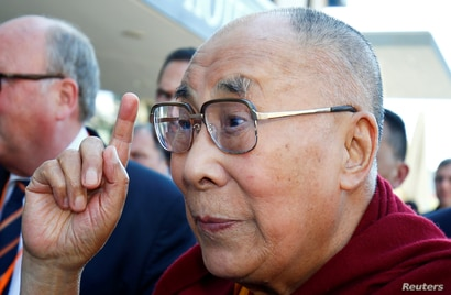FILE PHOTO: Tibetan spiritual leader the Dalai Lama gestures as he arrives at a hotel in Darmstadt, Germany, September 18, 2018…