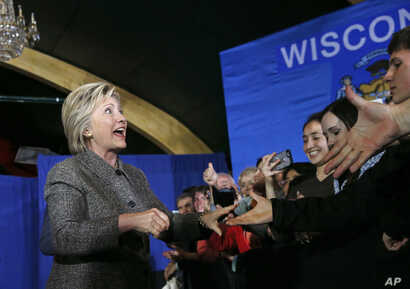 FILE - Democratic presidential candidate Hillary Clinton greets attendees before speaking at the Riverside Ballroom in Green Bay, Wis., March 29, 2016.
