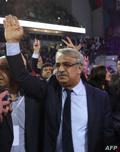 New co-chair of the pro-Kurdish Peoples' Democratic Party (HDP) Mithat Sancar waves as he attends the 4th Ordinary Peoples'…
