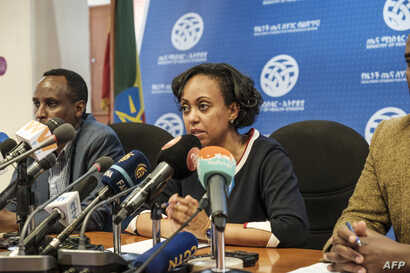 Dr. Lia Tadesse (2nd L), Minister of Health of Ethiopia, addresses the press during an urgent press conference at the Federal…