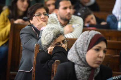 Laila Soueif, center,  the mother of Alaa Abdel Fattah, attends the retrial of her son and 24 others, in the courtroom in Cairo on Dec. 27, 2014.