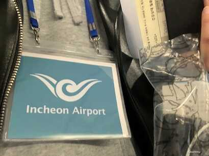 Necklaces are given to passengers who have symptoms of the coronavirus, or appear to, so that they can be moved to a pro-symptom area of the Incheon International Airport in South Korea. (Photo courtesy of Jaeyi Jeong)