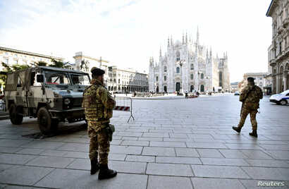 Military personnel are seen on Duomo square after the Italian government imposed a virtual lockdown on the north of the country, in Milan, March 8, 2020.