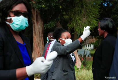 Health workers screen visitors to prevent the spread of coronavirus disease (COVID-19) at State House in Harare, Zimbabwe, March 19, 2020.