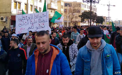 Algerians march in an anti-government demonstration in the Algerian city of Bordj Bou Arreridj, about 240kms east of the…