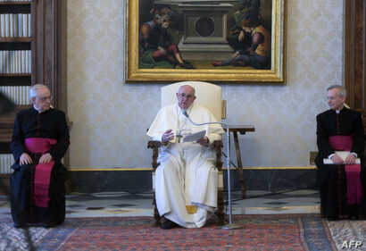 This handout photo taken and released on April 8, 2020 by the Vatican Media shows Pope Francis (C) speaking during a weekly…