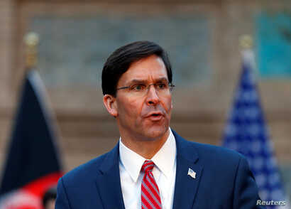 U.S. Defense Secretary Mark Esper, speaks during a joint news conference with Afghanistan's President Ashraf Ghani, and NATO…