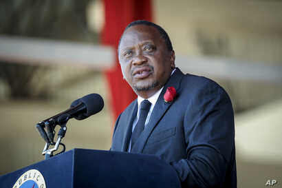Kenya's President Uhuru Kenyatta speaks during the state funeral of Kenya's former president Daniel arap Moi, at Nyayo Stadium…