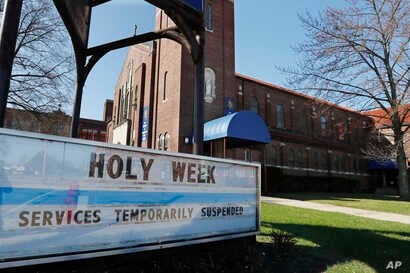 A sign highlighting Holy Week activities is displayed outside the Our Mother of Perpetual Help- St. James Parish, Wednesday,…