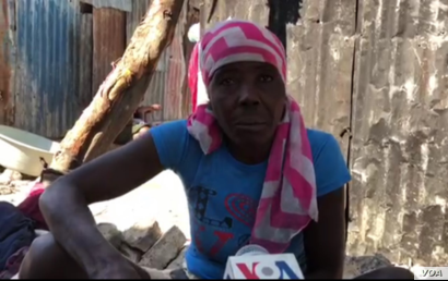 This street merchant, shown  in Port-au-Prince, Haiti, on April 3, 2020,  believes eating limes and drinking water infused with