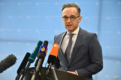 German Foreign Minister Heiko Maas addresses the media at the Foreign Ministry in Berlin on March 17, 2020, to comment on the…