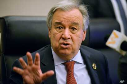 (FILES) In this file photo taken on February 8, 2020 United Nations Secretary-General Antonio Guterres speaks during a press…