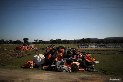 A pile of life jackets is seen in the spot where the government plans to build a new migrant detention centre, in the area of…