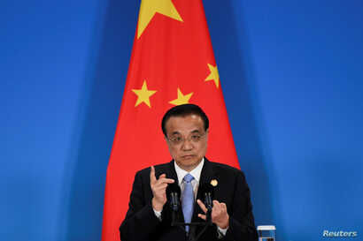 FILE PHOTO: China's Premier Li Keqiang speaks during a joint news conference at the 8th trilateral leaders' meeting between…