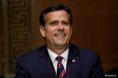 FILE PHOTO: U.S. Rep. John Ratcliffe (R-TX) testifies before a Senate Intelligence Committee nomination hearing on Capitol Hill…