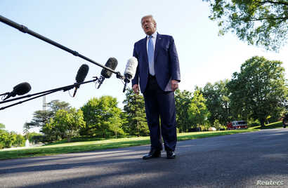 U.S. President Donald Trump talks to reporters as he departs for the Camp David, Maryland presidential retreat from the South…