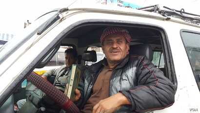 Omar Ali, 56, a bus driver, says he keeps his bus as clean as possible, but doesn't think the virus will spread in Sanaa, Yemen, May 4, 2020. (VOA/Naseh Shaker)