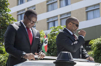 Lazarus Chakwera (L), the president for Malawi's main opposition Party, the Malawi Congress Party (MCP), and his election…