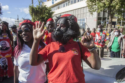 A United Transformation Movement supporter wears a unique mask as a preventive measure against the spread of the COVID-19 at Mount Soche hotel in Blantyre, May 6, 2020, Malawi.