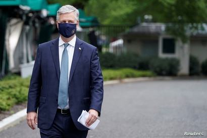 White House National Security Adviser Robert O'Brien walks after being interviewed at the White House in Washington, May 24, 2020.