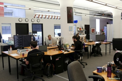 Reddit employees work at the company's headquarters in San Francisco, California April 15, 2014. Reddit, a website with a retro…