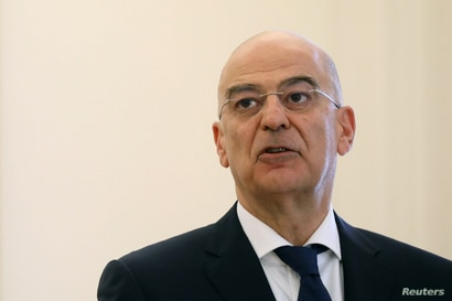 Greek Foreign Minister Nikos Dendias speaks during a joint statement with his Italian counterpart Luigi Di Maio at the Foreign…