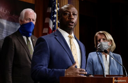 U.S. Senator Tim Scott (R-SC) is flanked by Senators Shelley Moore Capito (R-WV) and John Cornyn (R-TX) as he speaks