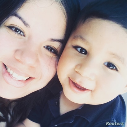 DACA recipient Brisa Rios poses for a photo with her son Yahir Rios in Oklahoma City, Oklahoma, in this handout photo released…