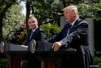 Poland's President Andrzej Duda listens to U.S. President Donald Trump during a joint news conference in the Rose Garden at the…
