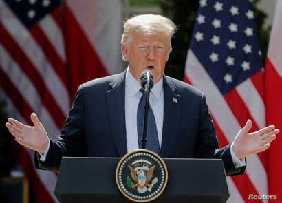 President Donald Trump takes questions during a joint news conference with Poland's President Andrzej Duda