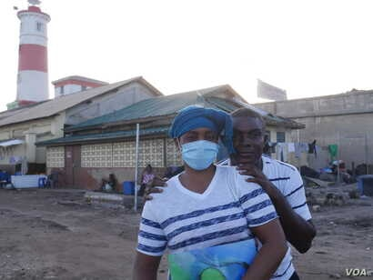 Naa Borkor and Emmanuel Quartey stand where their JayNii Streetwise Foundation once was, in James Town, May 29, 2020. (Stacey Knott/VOA)