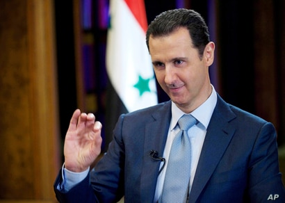 FILE - In this file photo released by the Syrian official news agency SANA, Syrian President Bashar Assad…