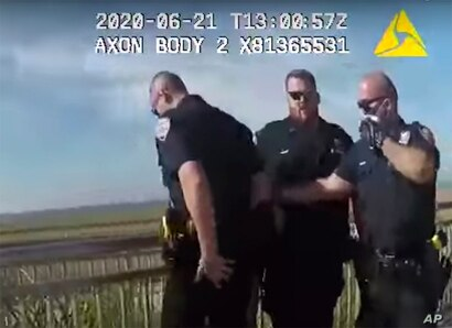 In this photo taken from police body cam video, New York Police officers, including officer David Afanador, right, arrest a man…